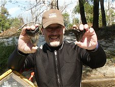 Diving & Digging for Fossils - Tom Lichauco was real happy with his two Megalodon teeth!