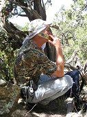 Glorieta Expeditions - Jim on the mountain ordering a pizza.