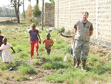 Thika, Kenya Expedition - Greg hunting with a few eager local kids who wanted to help.