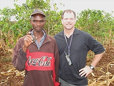 Thika, Kenya Expedition - Greg with local farmer who found a nice meteorite.