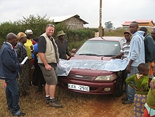 Thika, Kenya Expedition - Mike showing our driver and guide where to instruct locals to hunt for meteorites.