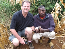 Thika, Kenya Expedition - Greg with a local who happened upon a beautiful meteorite while working.