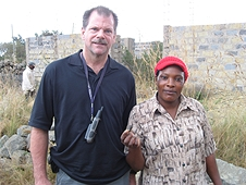 Thika, Kenya Expedition - Greg with local woman who found a nice little stone.