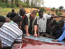 Thika, Kenya Expedition - Mike showing the strewnfield map to lcoals.