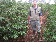 Thika, Kenya Expedition - Greg searches the rows between coffee trees.