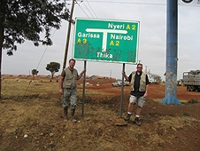 Thika, Kenya Expedition - Greg Hupe and Mike Farmer with Thika sign.
