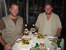 Thika, Kenya Expedition - Greg and Mike enjoying a feast of huge prawns and other local goodies.