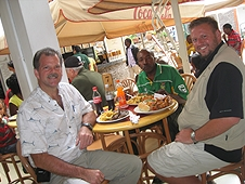 Thika, Kenya Expedition - Greg, Mike and Robert enjoying a tasty meal after cleaning up.