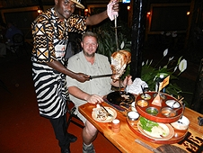 Thika, Kenya Expedition - Carnivore Restaurant - Mike asks for just a slice.