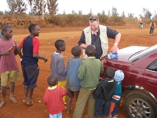 Thika, Kenya Expedition - Mike handing out more treats to the kids.