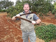 Thika, Kenya Expedition - Greg the mighty sword fighter in an avacado orchard.