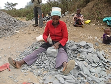 Thika, Kenya Expedition - Woman turning large fragments into smaller ones for use in roads.