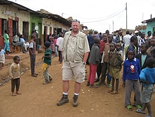 Thika, Kenya Expedition - Mike surrounded by kids in a village.