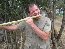 Thika, Kenya Expedition - Greg crunching on sugar cane. Lucky I didn't tear my teeth out!