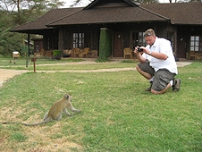 Thika, Kenya Expedition - Mike taking photos of a curious monkey.