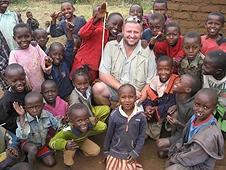 Thika, Kenya Expedition - Mike surrounded by happy Kenya kids.