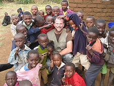 Thika, Kenya Expedition - The infectious laughter of these kids has Greg at all smiles!