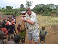 Thika, Kenya Expedition - The kids loved being swung upside down by Mike.