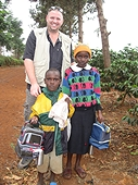 Thika, Kenya Expedition - Mike with kids who received lunch boxes.